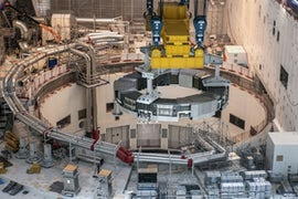 Sixth Poloidal Field Coil Inserted Into Tokamak Pit